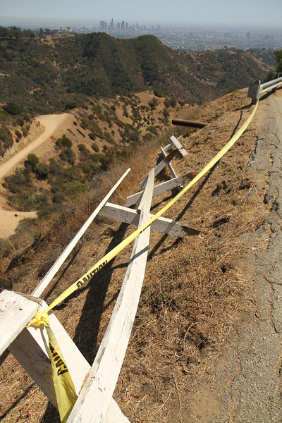 Caution tape guard rail overlooking Griffith Park. August 27, 2011.