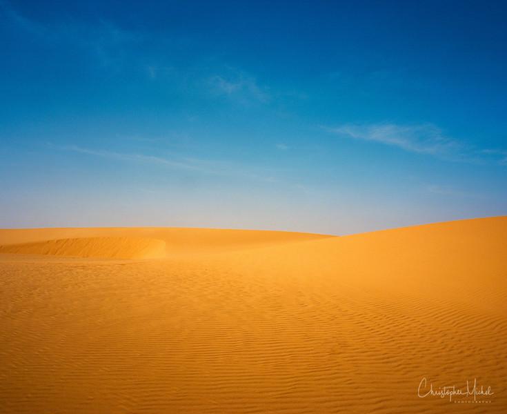 Sudan's color palette - blue and orange.