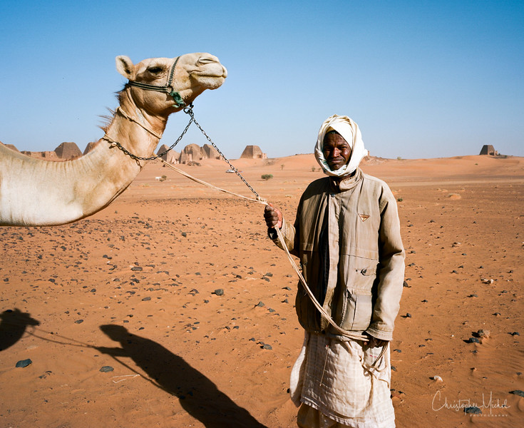 Local villagers are ready and willing to let you ride their camel.  For a price!
