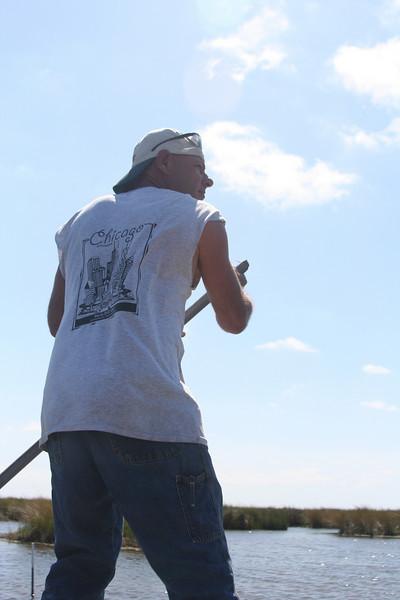 Rick poling the skiff