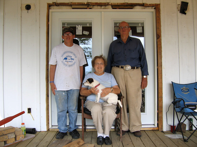 The Russ Family of Pearlington, Mississippi -- (l to r) Leslie, Mrs. Nancy Russ, Suszie, and Mr. Charles Russ -- standing in front of one of their three new French doors, furnished by International Disaster Emergency Services and installed by team members from Newport First Christian Church.