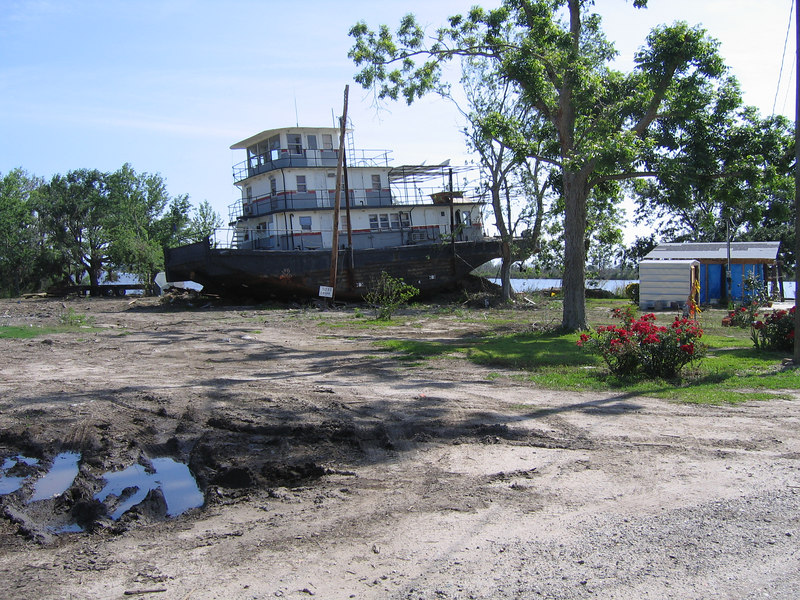 According to the locals (this is in Pearlington, Mississippi), this old boat had been made into a bed and breakfast before it landed here. The river seen in the background is the Pearl river and the other side of it is in Louisiana.