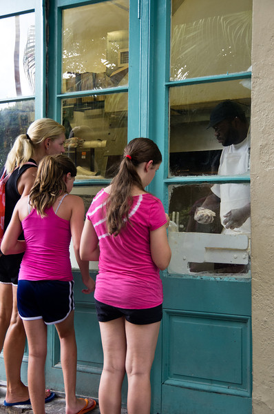 Watching beinets being made at Cafe Du Monde