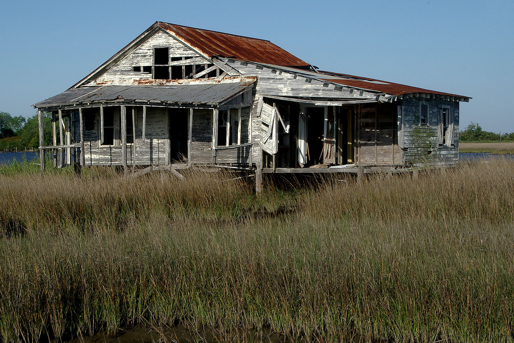 This abandoned home is in Leeville, LA.  It is now surrounded by marsh and industry.