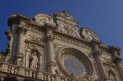 Yes, they took great pride in making their facades as busy as possible. It is Baroque.