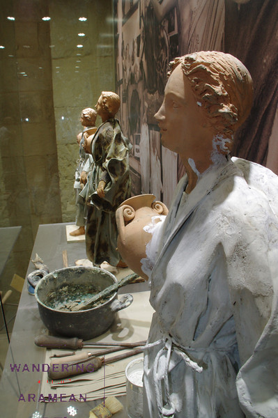 A display showing the process of forming the paper mache