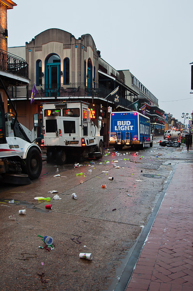 Street sweepers pick up the debris as the Bud Light truck rolls ahead to restock for another day.