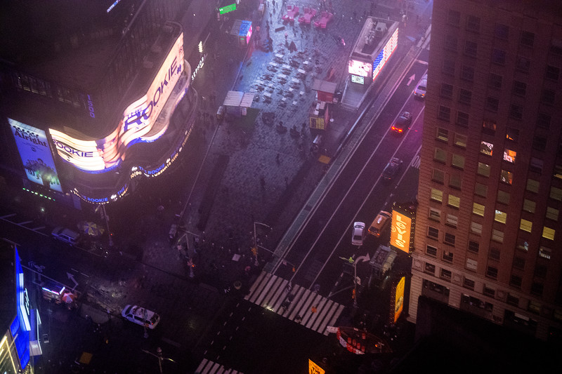"…Times Square, near midnight…<br /> <br /> BTW, those funny Gumby-shaped pink things at the top -- if you have not been there for a while as we had not -- are recumbent benches for gazing up at the verticals.<br /> <br /> ""No Sleeping. Twenty minutes maximum allowed"""