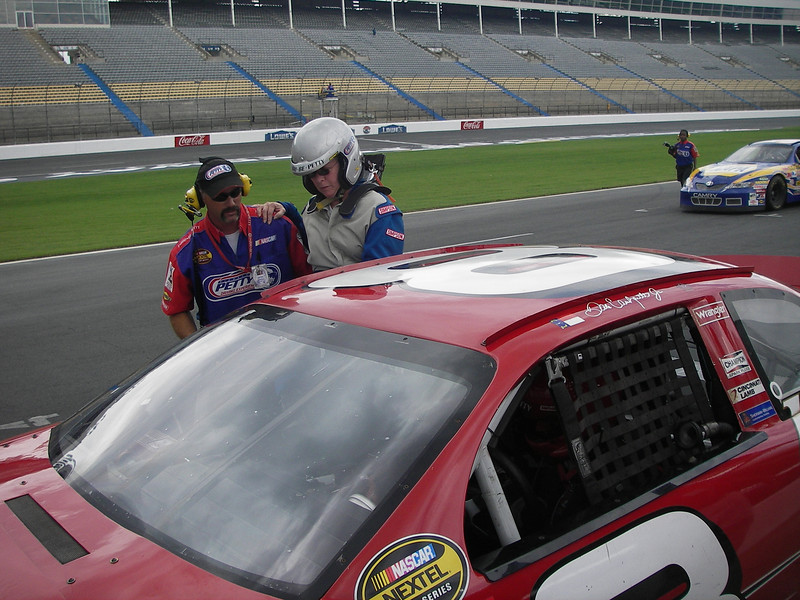 Climbing in the window.  For those that don't know NASCAR stock cars do not have doors