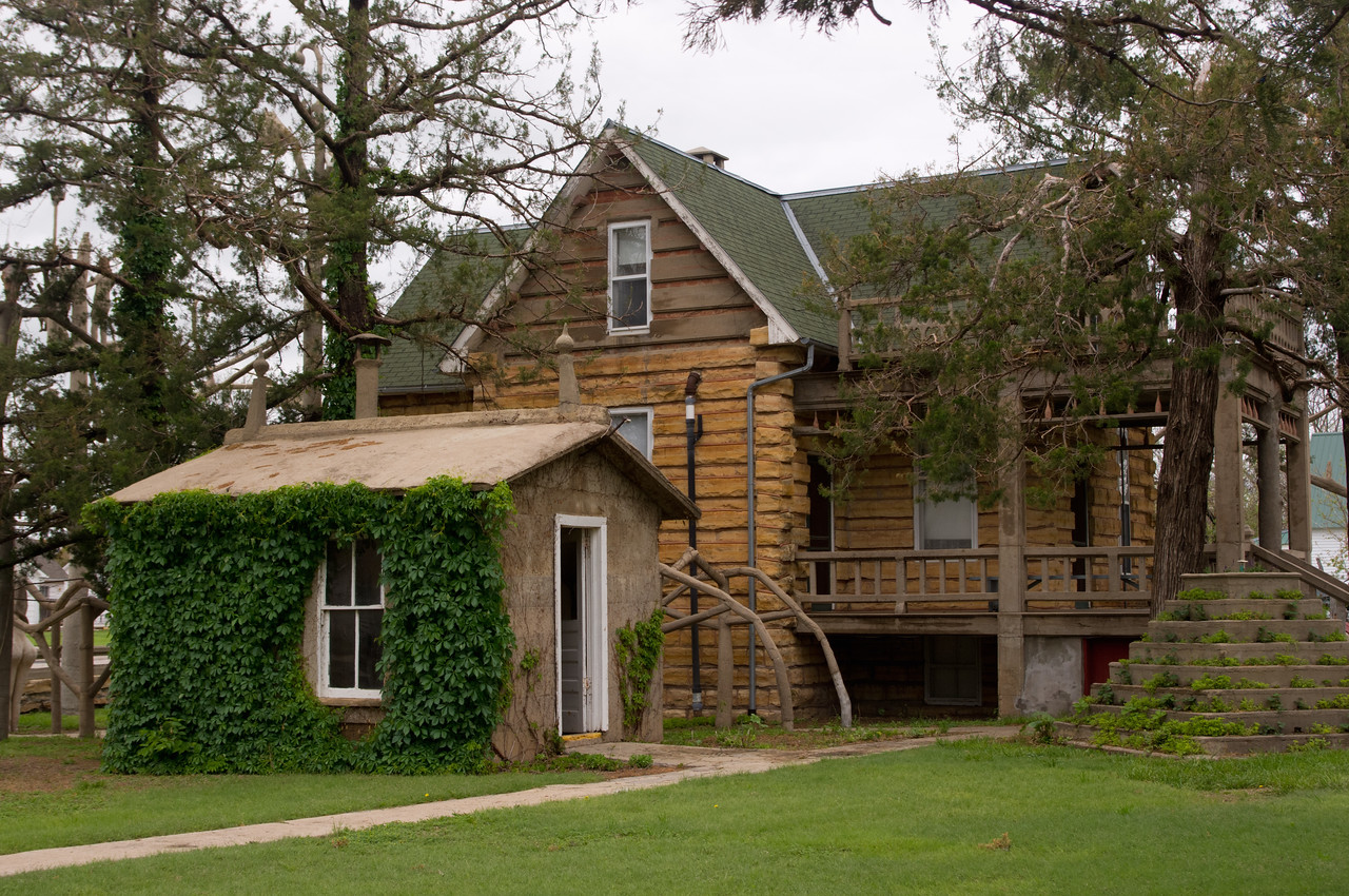 """Log"" home built by Samuel P. Dinsmoor is actually made from limestone - notice the notched corners. Dinsmoor's home is part of an attraction in Lucas, Kansas, now called The Garden of Eden."