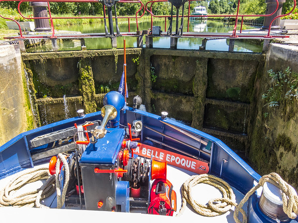 I watch as—with just inches to spare on either side—the barge squeezes gently into the locks and the gates shut