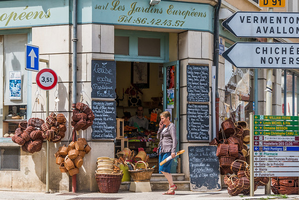 A street scene in the bustling country village of Chablis, with garden shops, tasting rooms, and cafes everywhere.