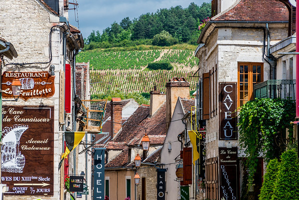 A street scene in Chablis with vineyards in the distance, on the hillside. Picture perfect!