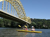 Lydia & Seth kayaking under the 16th St. Bridge on the Allegheny River