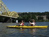 Lydia & Seth kayaking towards 16th St. Bridge on the Allegheny River