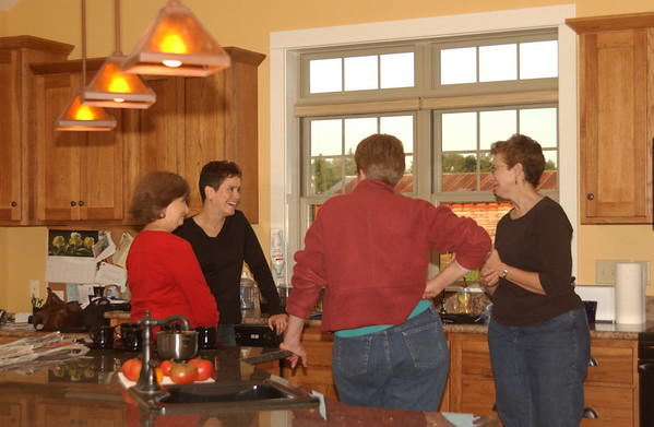 Rob's cousins in kitchen of Jon & Leanna's new house