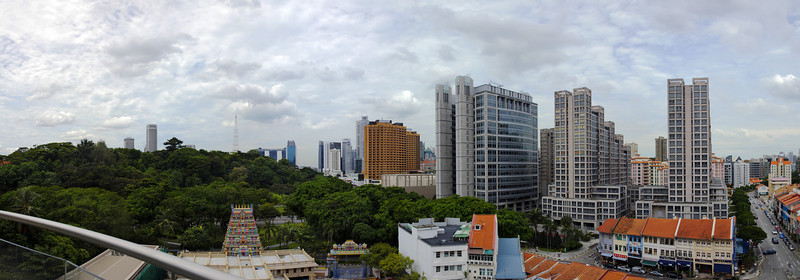 The view from the balcony of the Imperial Condominiums looking southeast toward Marina Bay. You can see the 3 hotel towers of the Marina Bay project with the Skypark across the tops just to the left of center.