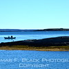 Using long telephoto lens, lobstermen captured rowing past pier on Bailey's Island. [UFP101312]