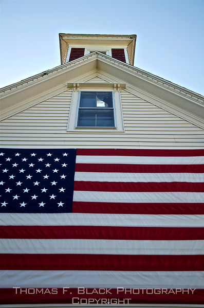 Gigantic cloth flag adorns exterior of general store in Tenants Harbor, another intimate fishing village. Being diplomatic, we didn't ask whether the owner planned to vote for Obama or Romney, although we had an inkling of which voting-booth lever would be pulled. [UFP091712]