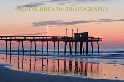 FISHING PIER EARLY MORN!   This was the fishing Pier in the last stages of Twilight before the Sun Rose above the clouds.  Notice the automatic light on the pier is still on. The Pinks and Blues were Awesome!
