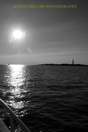 LIGHTHOUSE FROM THE BOAT IN BLACK & WHITE