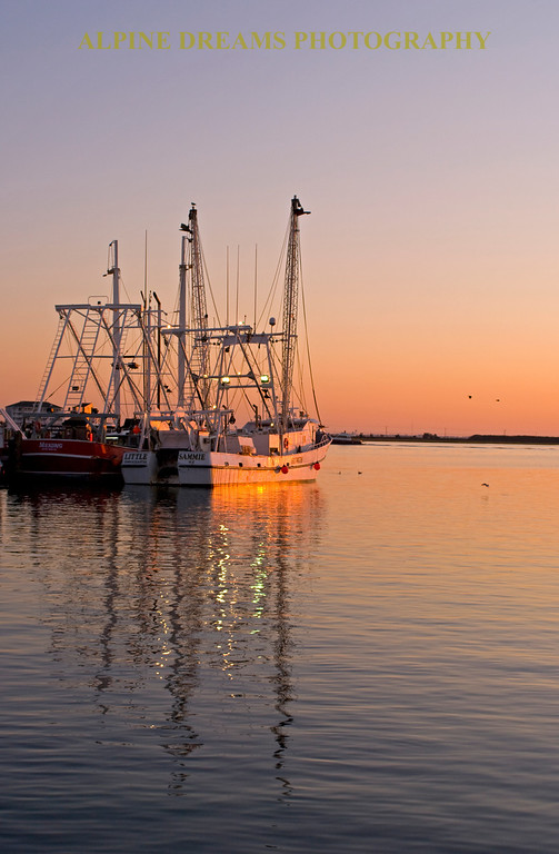 Called MORNING REFLECTIONS I moved the tripod back  and went for the sun hitting the white hull and the masts and rigging in the reflections. My tripod was a must.