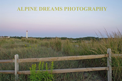 I tried to get many different views of the CAPE MAY Lighthouse . Simply called FENCE & LIGHTHOUSE this shot was taken at dawn. The sun was behind me.  Notice the line of pink sky above the lighthouse.