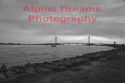 INLET BRIDGE in BLACK & WHITE.  About a mile in off the main coastal highway I got this angle from the inlet shore. Transportation was by bicycle so I used a piling for a tripod.  Quite an impressive bridge.