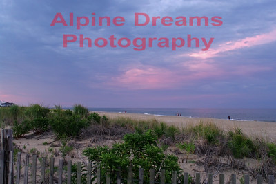 A thunderstorm had passed through the island but gave way to this beautiful purle haze in the clouds. I was blown away by the hue being picked up on the water. The humidity and haze helped to soften this medley of dune, beach, sea & sky!  I called this  PURPLE SKY AT THE BEACH!