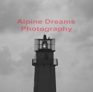 FENWICK ISLAND LIGHT in BLAK & WHITE.  I know that I only shot the top of the lighthouse because of the natural sunlight coming through the lens on an otherwise cloudy day.  Perfect for Black & White.