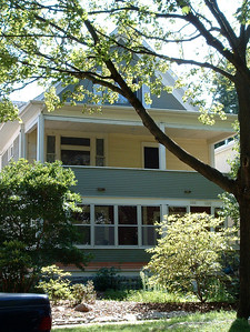 1198-1200 Laurel, where we lived 1939-1956. The lower porch was not enclosed, had a bench-like wood swing, and was screened in summer.