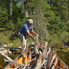 While Jim and Jim fished, Tom and Beth gathered firewood.