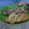 First dinner: ribeye steaks grilled, potatoes roasted with onions and butter, and salad.<br /> July 19, 2012 on the shore of Crab Lake, MN.