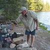 Jim grills the steaks while standing upwind.