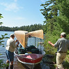 "Jim and Tom prepare to unload the Kevlar canoes off our ""tow"" after trip across Burntside Lake, MN to Crab Lake Landing to enter the Boundary Waters Canoe Area.<br /> July 19, 2012"
