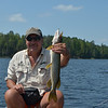 Tom with a good-sized pike.<br /> July 20, 2012