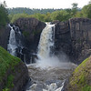 High Falls of the Pigeon River, around which the Grand Portage trail was necessary.  The portage trail was developed by the native peoples long before the European traders used it during the 1600s and 1700s as the pathway to the interior. <br />  U.S.A. on left, Canada on right.
