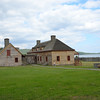 Grand Portage National Monument.  Recreated Trading Post's kitchen on left and Great Hall on right with Lake Superior beyond.<br /> July 23, 2012