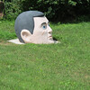 Yard art, somewhere in the boonies of Wisconsin. Modeled after a GI Joe head?