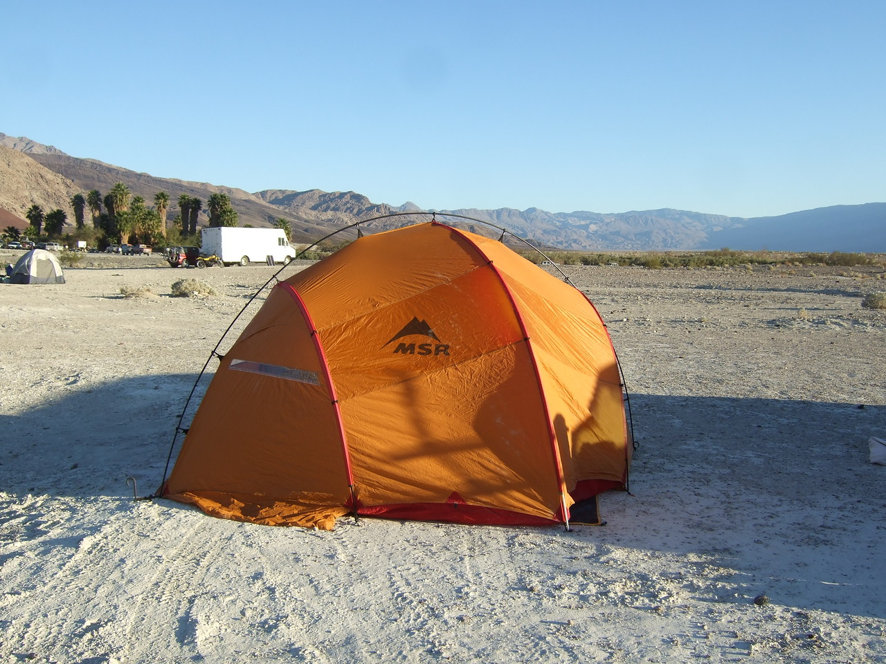 A view of the tent showing the logo and a door.