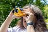 Denise Lantz using binoculars