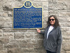 Denise Lantz with plaque commemorating the completion of Highway 401 at Mallorytown OnRoute