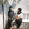 The author sits beside a life-size replica of a Macanese, or a woman of Macau with Portuguese ancestry, at the Macau Museum.