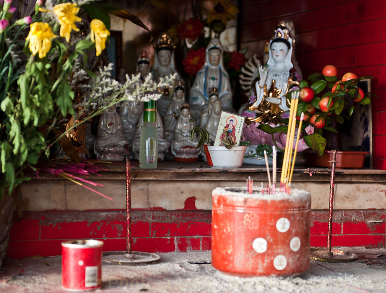 Detail from one of the many street shrines around the island.