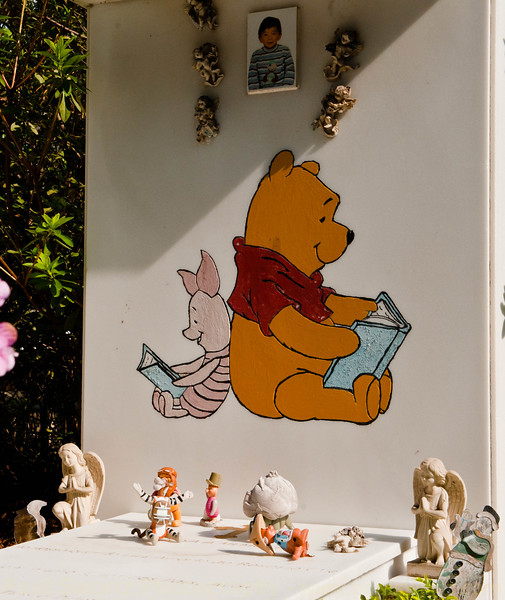 Oddly out of place, this child's grave is a testament to the appeal of Pooh Bear
