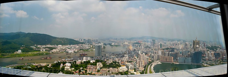 Stitched view (through glass, alas) from the top of the Macau Tower.