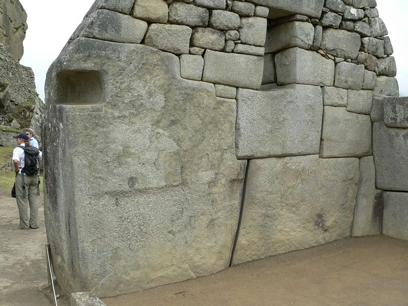 Pay attention to the edges of the stones and how they are fit together. The large one is easily 12 feet tall.