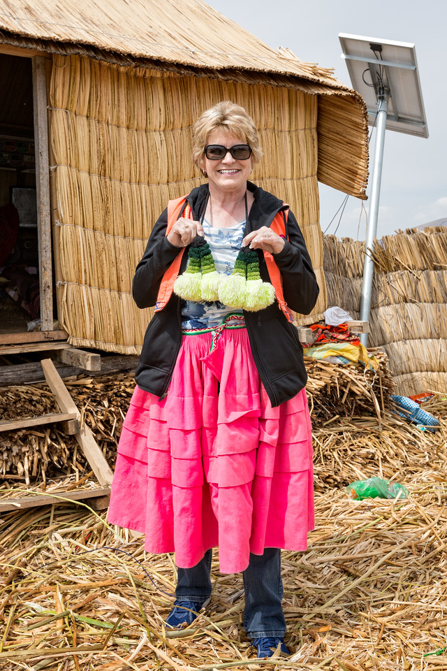 President Juana loans Jenny her colorful clothing for posing in Peruvian style