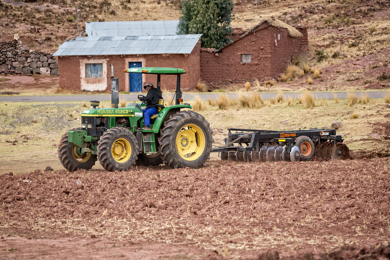 John Deere Tractor Disking to Prepare For Potato Planting