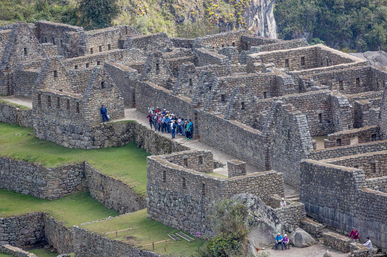 Tour Group Explores Machu Picchu